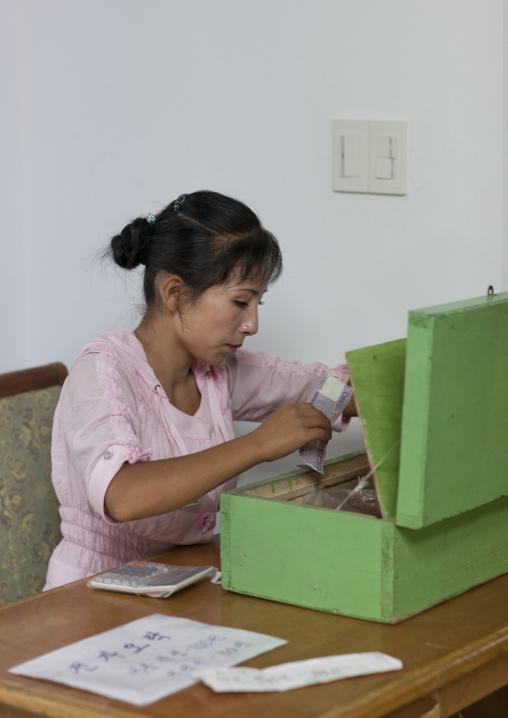 North Korean cashier woman at Kaeson youth park, Pyongan Province, Pyongyang, North Korea