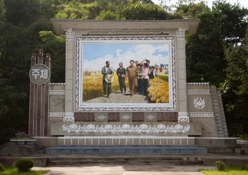 Propaganda fresco of Kim Jong il with farmers, Kangwon Province, Wonsan, North Korea