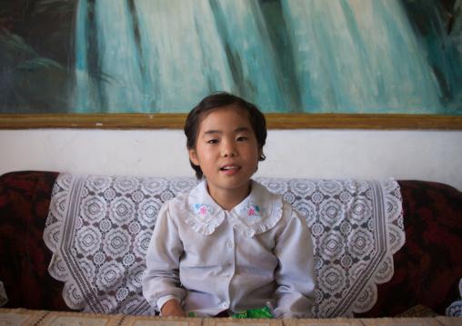 Portrait of a North Korean girl inside her home, South Pyongan Province, Chonsam Cooperative Farm, North Korea