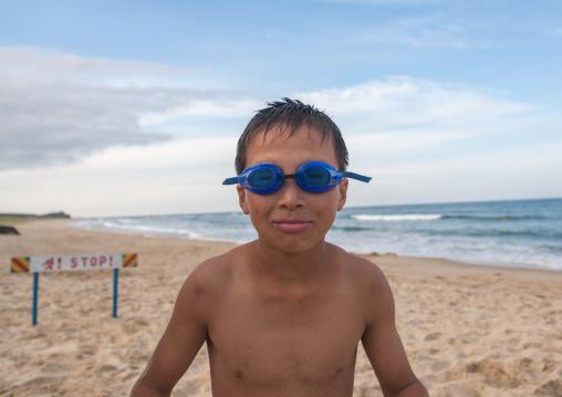 North Korean boy having fun at the beach, North Hamgyong Province, Chilbo Sea, North Korea