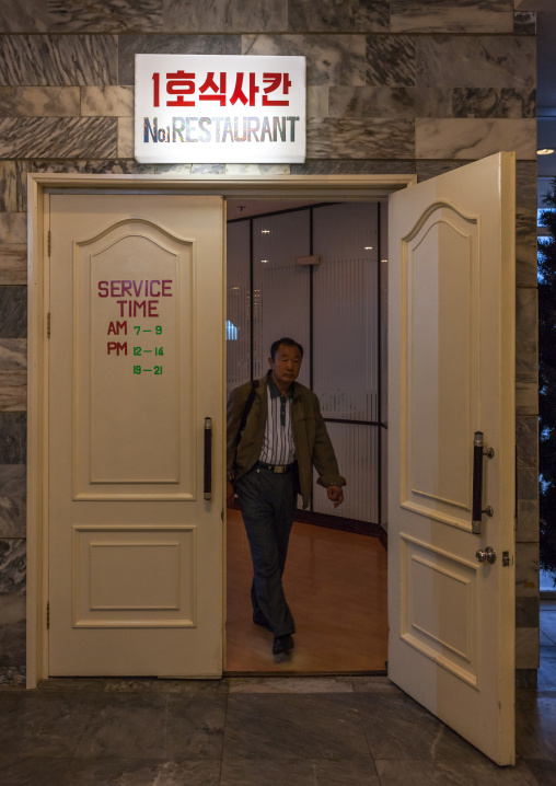 North Korean man coming out of the number one restaurant in yangakkdo hotel, Pyongan Province, Pyongyang, North Korea