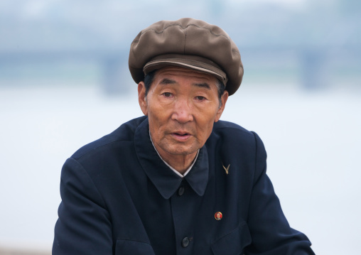 Portrait of senior North Korean man with a cap, Pyongan Province, Pyongyang, North Korea