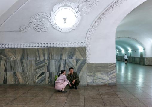 North Korean couple resting in the subway station, Pyongan Province, Pyongyang, North Korea