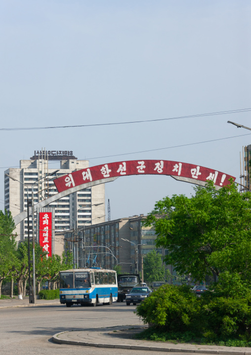 Red propaganda billboard over a road about songun military first policy, Pyongan Province, Pyongyang, North Korea