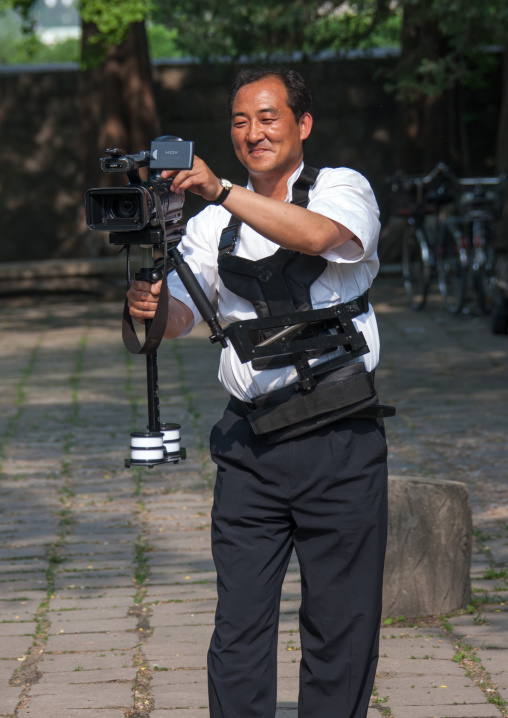 Portrait of a North Korean television cameraman with a steadycam, North Hwanghae Province, Kaesong, North Korea