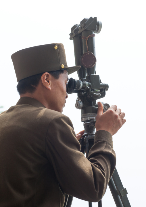 North Korean soldier looking south Korea with binoculars at the Demilitarized Zone, North Hwanghae Province, Panmunjom, North Korea