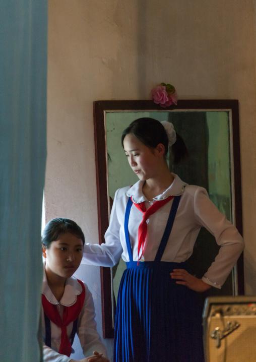 North Korean pioneers teenage girls backstage before a show in their college, Pyongan Province, Pyongyang, North Korea