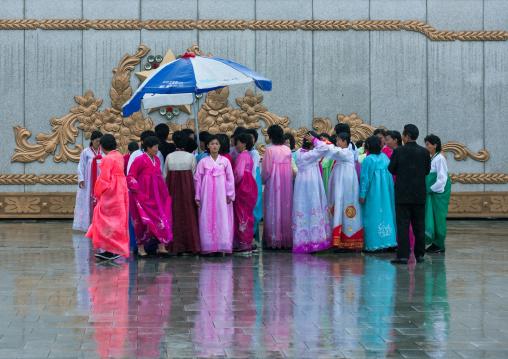 North Korean people under the rain in Kumsusan memorial palace, Pyongan Province, Pyongyang, North Korea