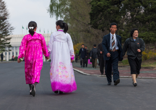 North Korean people with traditional and modern clothes in the street, Pyongan Province, Pyongyang, North Korea