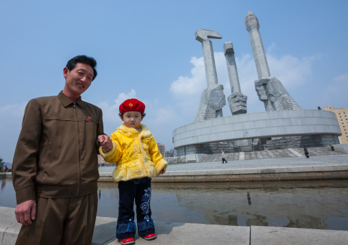 North Korean father and daughter near monument to Party founding, Pyongan Province, Pyongyang, North Korea