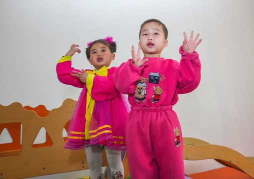 North Korean children in an orphanage singing a patriotic song, South Pyongan Province, Nampo, North Korea
