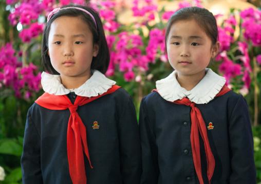 North Korean pioneers girls in the international Kimilsungia and Kimjongilia festival, Pyongan Province, Pyongyang, North Korea