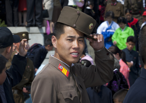 North Korean soldier with a relaxed attitude in the street, Pyongan Province, Pyongyang, North Korea