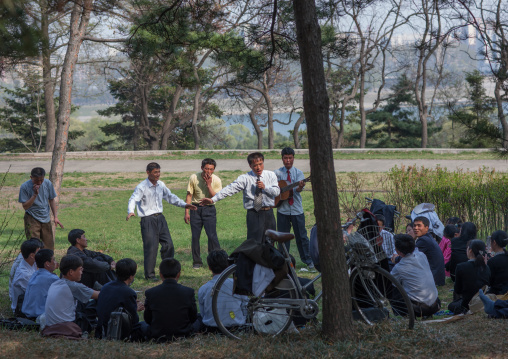 North Korean people celebrating april 15 the birth anniversary of Kim Il-sung in a park, Pyongan Province, Pyongyang, North Korea