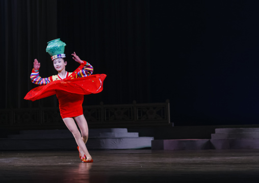 North Korean acrobat girl with a pottery on the stage of Mangyongdae children's palace, Pyongan Province, Pyongyang, North Korea