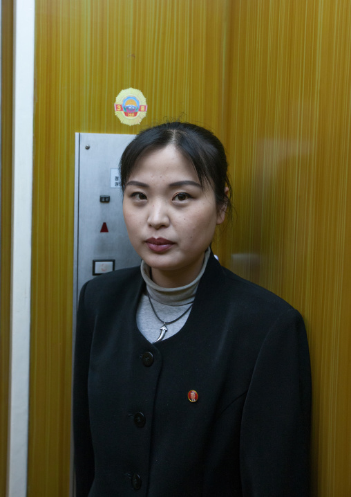 North Korean woman inside an elevator in the Grand people's study house, Pyongan Province, Pyongyang, North Korea