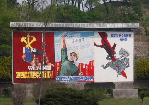 Row of North Korean propaganda billboards in the street, Pyongan Province, Pyongyang, North Korea