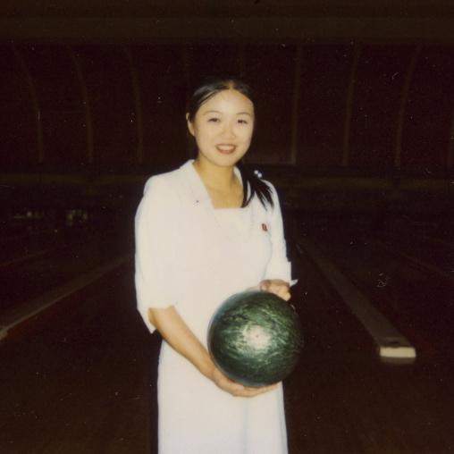 Polaroid of a smiling North Korean woman in a bowling, Pyongan Province, Pyongyang, North Korea