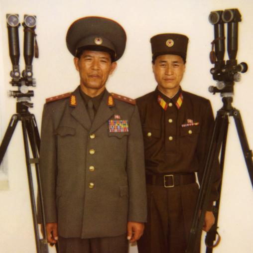 North Korean soldiers standing near binoculars on the Demilitarized Zone, North Hwanghae Province, Panmunjom, North Korea