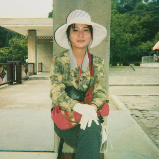 Polaroid of a smiling North Korean woman with a hat, Pyongan Province, Pyongyang, North Korea