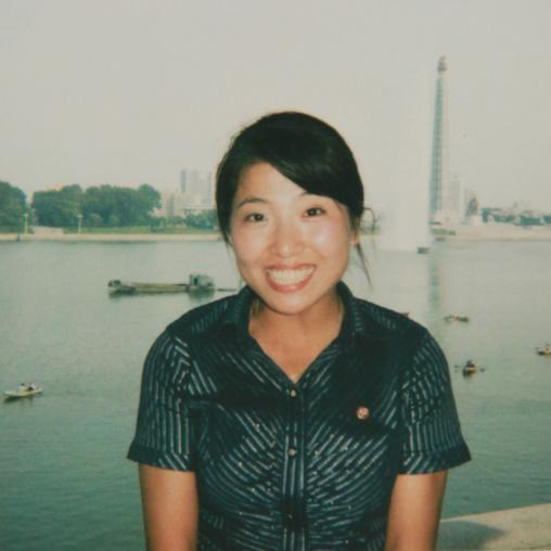 Polaroid of a smiling North Korean woman in front of Taedong river, Pyongan Province, Pyongyang, North Korea