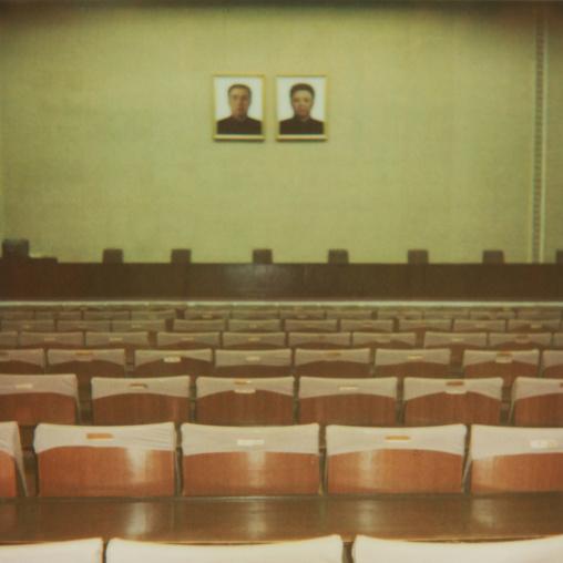 Polaroid of the Dear Leaders portraits in a meeting room, Pyongan Province, Pyongyang, North Korea