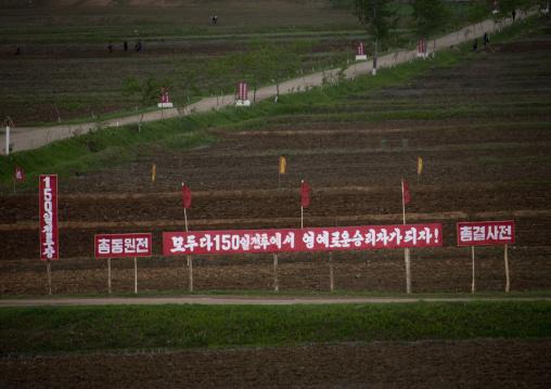 Propaganda slogan for the 150 days of labor campaign on a red billboard in town, Pyongan Province, Myohyang-san, North Korea