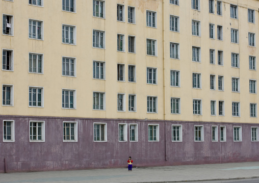 North Korean child in front a building in the street, Pyongan Province, Pyongyang, North Korea