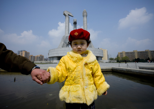 North Korean father and daughter near the monument to the foundation of the workers' Party, Pyongan Province, Pyongyang, North Korea