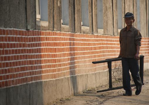 North Korean worker walking in the street, North Hwanghae Province, Kaesong, North Korea