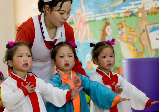 North Korean triplets in an orphanage with a nurse, South Pyongan Province, Nampo, North Korea