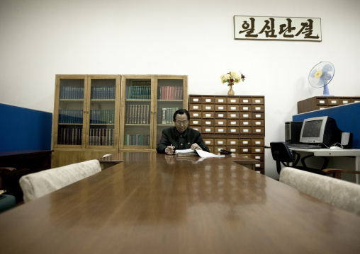North Korean expert who answers the questions of the visitors in the Grand people's study house, Pyongan Province, Pyongyang, North Korea