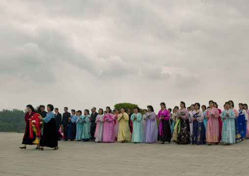 North Korean women going to pay respect to the statues of the Dear Leaders in Mansudae Grand monument, Pyongan Province, Pyongyang, North Korea