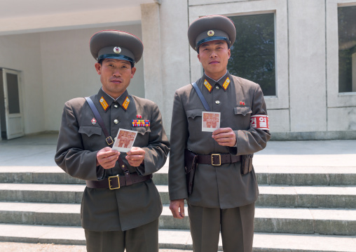 North Korean soldiers with polaroids in the joint security area of the Demilitarized Zone, North Hwanghae Province, Panmunjom, North Korea