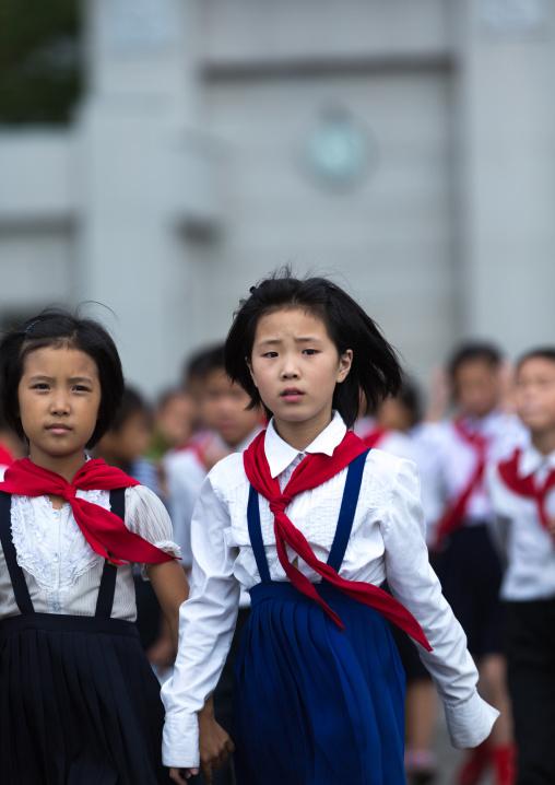 North Korean pioneers girls in the street, Pyongan Province, Pyongyang, North Korea