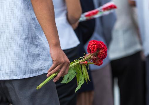 North Korean people bringing flowers to pay respect to the Leaders in Mansudae art studio, Pyongan Province, Pyongyang, North Korea