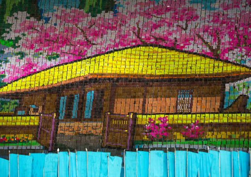 Kim il Sung Mangyongdae native house made by children pixels holding up colored boards during Arirang mass games in may day stadium, Pyongan Province, Pyongyang, North Korea