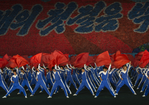 North Korean gymnasts with red flags during the Arirang mass games in may day stadium, Pyongan Province, Pyongyang, North Korea