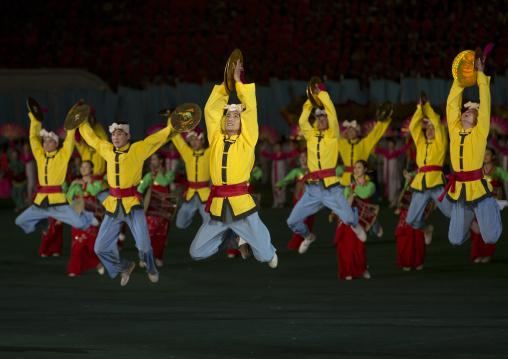 North Korean acrobats jumping at Arirang mass games in may day stadium, Pyongan Province, Pyongyang, North Korea