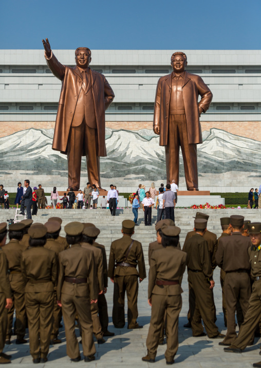 North Korean soldiers in front of the statues of the Dear Leaders in Mansudae Grand monument, Pyongan Province, Pyongyang, North Korea