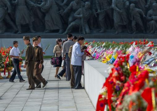 North Korean people putting flowers in Mansudae Grand monument, Pyongan Province, Pyongyang, North Korea