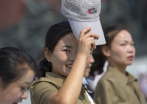 Smiling North Korean woman with a cap in the street, Pyongan Province, Pyongyang, North Korea