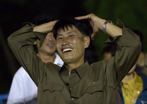 North Korean man coming down from a roller coaster in Kaeson youth park, Pyongan Province, Pyongyang, North Korea