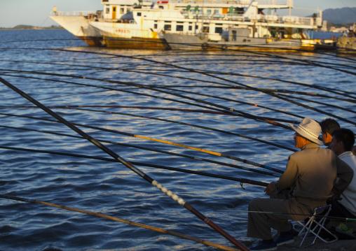 North Korean men fishing in the port, Kangwon Province, Wonsan, North Korea