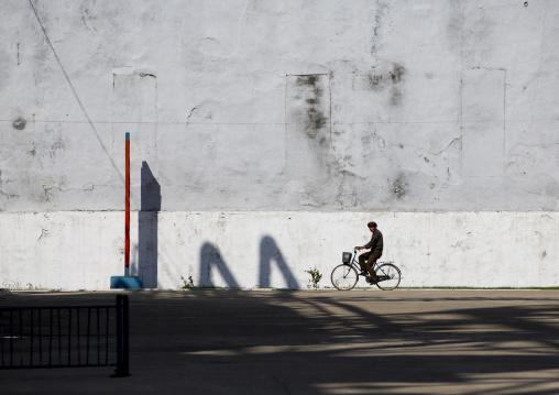 North Korean man riding a bicycle in Hungnam nitrogen fertilizer plant, South Hamgyong Province, Hamhung, North Korea