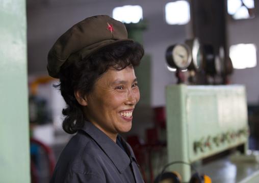 Smiling North Korean worker woman at Hungnam nitrogen fertilizer plant, South Hamgyong Province, Hamhung, North Korea