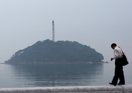 North Korean man in front of a small island, South Hamgyong Province, Hamhung, North Korea
