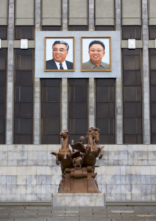 Kim il Sung and Kim Jong il giant portraits in front of Mangyongdae children's palace, Pyongan Province, Pyongyang, North Korea