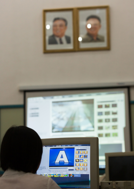 Video editing classroom under the portraits of the Dear Leaders in Mangyongdae children's palace, Pyongan Province, Pyongyang, North Korea