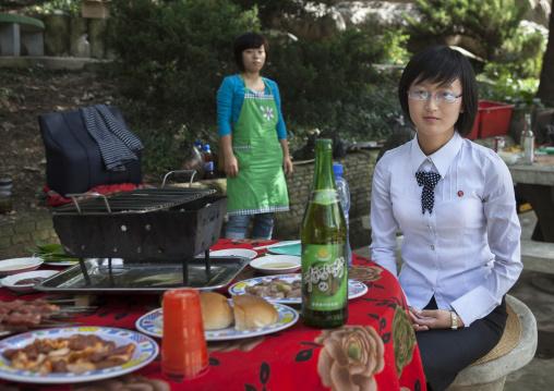 North Korean woman enjoying a picnic in a park on a sunday, Pyongan Province, Pyongyang, North Korea